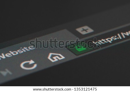 Web browser closeup on LCD screen with shallow focus on https padlock. Internet security, SSL certificate, cybersecurity, search engine and web browser concepts #1353121475