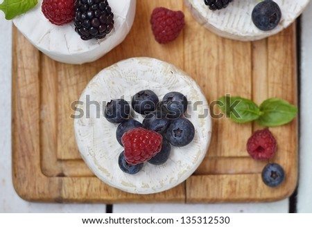 Camembert cheese with  wild berries #135312530