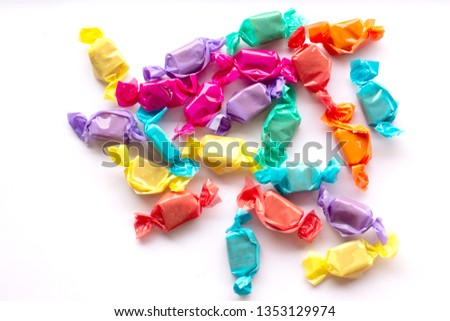 Candies isolated on white background. Sweet candy , toffee , candies isolated white background. Caramel toffee candy in colorful package on white background. #1353129974