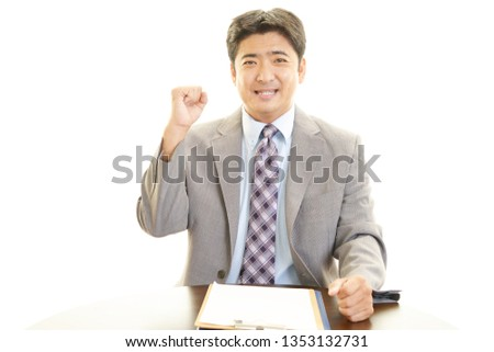 Asian businessman enjoying success. #1353132731