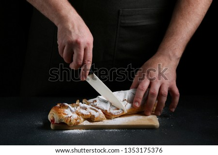 pie on dark with hand. concept of decorating bakery. pie making concept. #1353175376