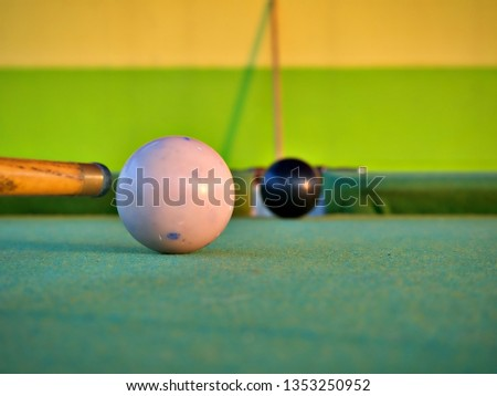 Cue stick aiming for the white ball to shoot black billiard ball to the hole #1353250952