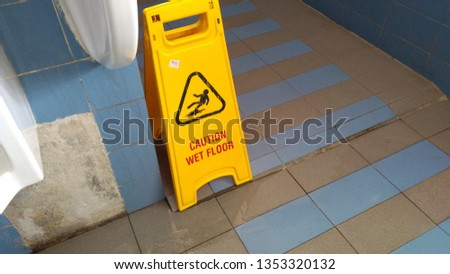 The safety first yellow floor cautioned the signage has a wet floor and cleaning, Cleaning in progress, Thanks for your cooperation #1353320132