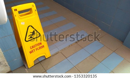 The safety first yellow floor cautioned the signage has a wet floor and cleaning, Cleaning in progress, Thanks for your cooperation #1353320135