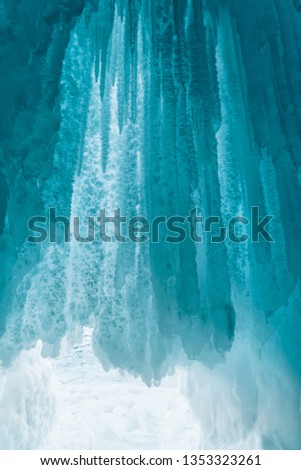 Turquoise and blue icicles. Ice hangs in an ice cave. Baikal, Russia. #1353323261