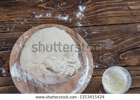 dough on a wooden Board, shot from above. with free text space. #1353415424