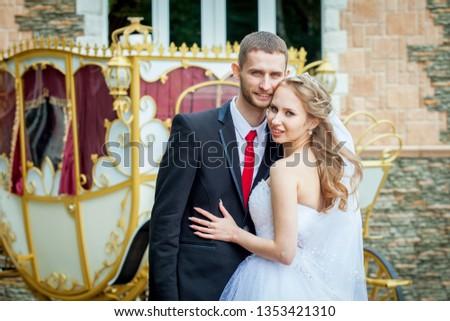 portrait of happy newlyweds, bride embracing groom smiling #1353421310