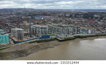Aerial drone photo from residential area of Greenwich village next to river Thames, London, United Kingdom #1353512444