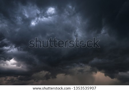 Scary epic sky with menacing clouds. Hurricane wind with a thunderstorm. Stock background, photo