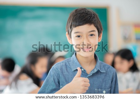 Asian primary student and teacher in the classroom  #1353683396