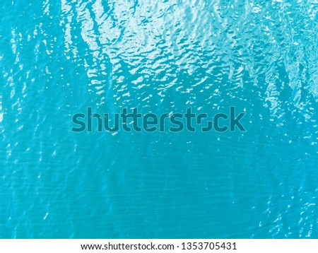 Aerial view of a Crystal clear sea water texture. View from above Natural blue background. Turquoise ripple water reflection in tropical beach. Blue ocean wave. Summer sea. Drone. Top view #1353705431