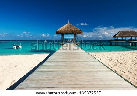 Beautiful beach with jetty at Maldives #135377537