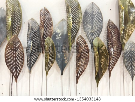 Decorative ornament with leaf made from metal on white background. #1354033148