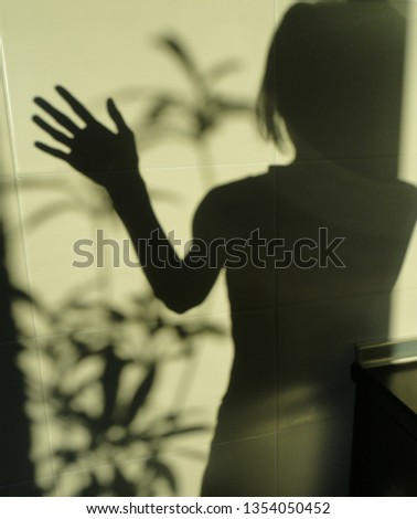 lights and shadows girl on a wall texture background #1354050452