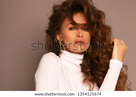 fashion studio photo of beautiful sexy girl with dark curly hair in elegant clothes  #1354125674