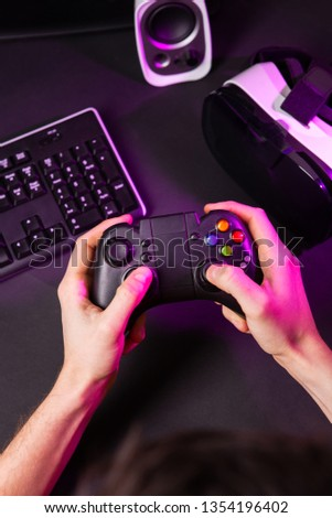Man hands playing a computer game with a game joystick. #1354196402
