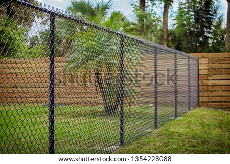 Black Chain Link Fence Royalty-Free Stock Photo #1354228088