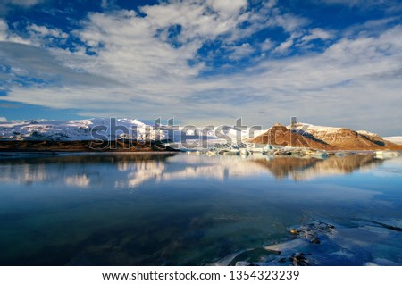 Reflection in frozen water of Glacier in Iceland  #1354323239