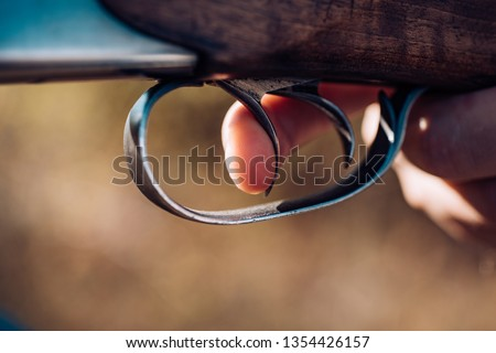 Hunter with shotgun gun on hunt. Poacher with Rifle Spotting Some Deers. Pulled the trigger of the shotgun. Big game. Copy space for text #1354426157