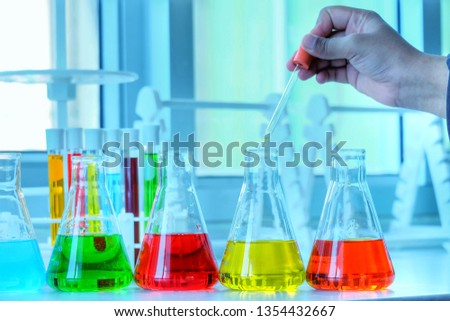 Chemical tube set development and pharmacy in laboratory  with multicolored substances in laboratory - Image #1354432667