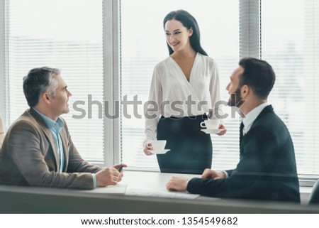 The business people sitting at the office table #1354549682