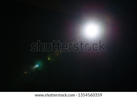 Flash of a distant abstract star. Abstract sun flare. The lens flare is subject to digital correction. - Image #1354560359