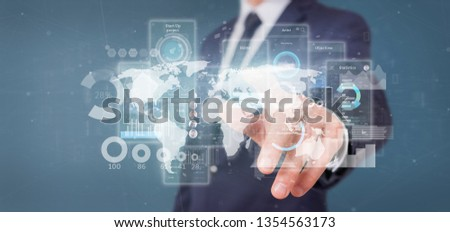 View of Businessman holding User interface screens with icon, stats and data 3d rendering #1354563173
