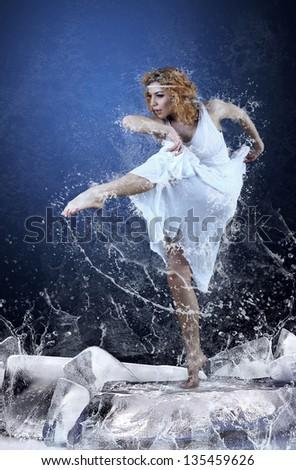 Jump of ballerina on the ice dancepool around splashes of water drops #135459626