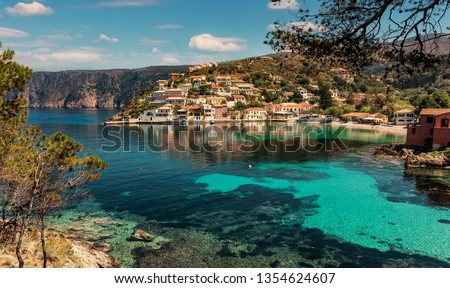 Wonderful summer seascape of Ionian Sea. Wonderful place for holiday. Amazing Greece. Picturesque colorful village Assos in Kefalonia. Turquoise colored bay in Mediterranean sea. Amazing postcard  #1354624607