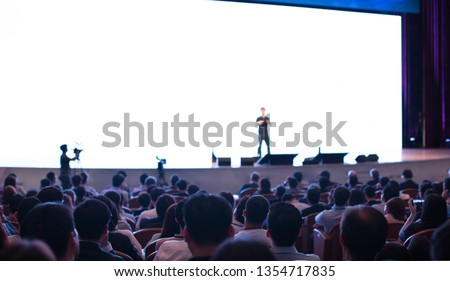 Speaker at Talk in Business Conference. Tech Executive Entrepreneur Speaker on Stage at Conference. Presenter Giving Business Presentation at Meeting. Corporate Exhibition for Investors Event.  #1354717835