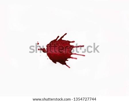 Blood splatters on white background #1354727744