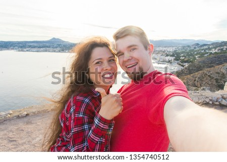 Travel, vacation and holiday concept - Beautiful couple having fun, taking selfie, crazy emotional faces and laughing. #1354740512
