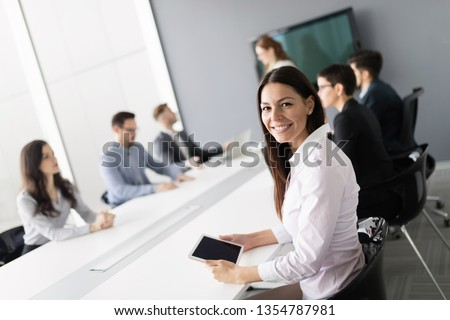 Business colleagues in conference room working together #1354787981