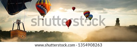 Beautiful panoramic nature landscape of countryside mountains with colorful high hot air balloons festival in summer sky. Vacation travel panorama background. #1354908263