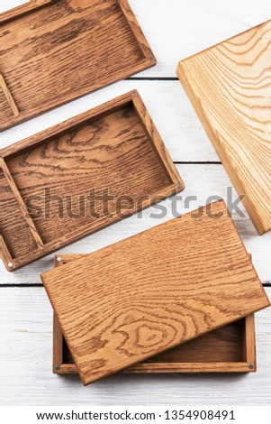 Wooden photo box for photo storage on wooden white background #1354908491