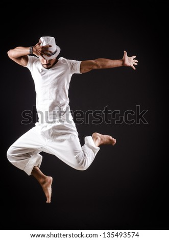Dancer dancing dances in white clothing #135493574