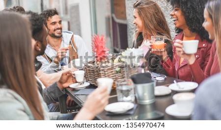 Group of happy friends drinking coffee and cappuccino at vintage bar outdoor - Young millennials people doing breakfast together - Friendship, youth and food concept - Focus on blond top girl face #1354970474