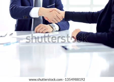 Group of business people or lawyers shaking hands finishing up a meeting , close-up. Success at negotiation and handshake concepts #1354988192