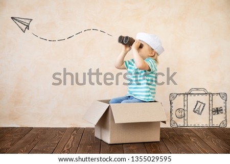 Happy child pretend to be sailor. Funny kid playing at home. Summer vacation and travel concept #1355029595