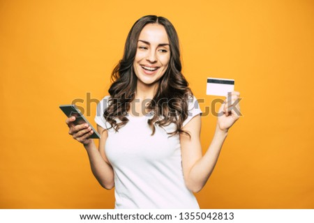 Like falling off a log. A picture which shows an easy way of using modern gadgets through the experience of cute girl who has only pleasant emotions from doing it. #1355042813