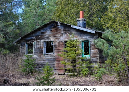 A long forgotten abandoned cabin, deep in the woods.  #1355086781