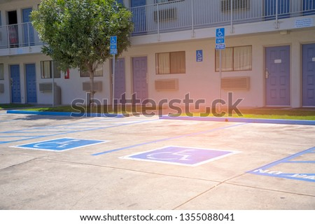 Free space Handicapped parking spot in motel or apartment, transportation infrastructure road markings.