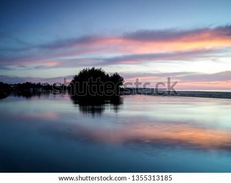 Seascape: beautiful colorful sunset over the ocean coast #1355313185