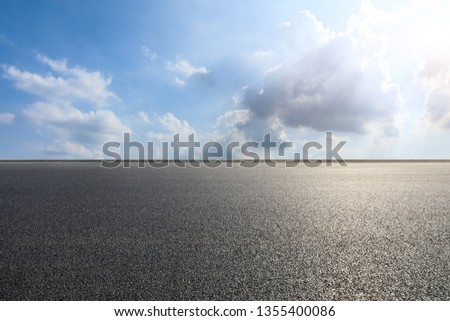 Empty asphalt road and blue sky with white clouds scene #1355400086