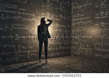 Back view of young businesswoman in concrete corner with mathematical formulas. Complex algorithm and math concept #1355412755
