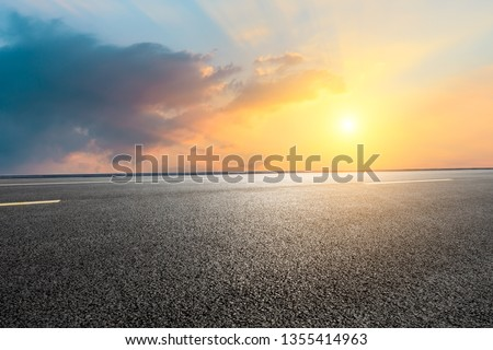 Empty asphalt road and beautiful sky clouds at sunset #1355414963