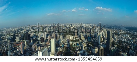 panorama cityscape on the day of dust smoke toxic air Bangkok city center with blue sky background shooting camera at landmark mahanakorn sky walk Thailand #1355454659