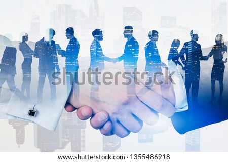 Double exposure with business handshaking on Singapore skyline #1355486918