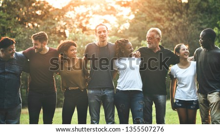 Cheerful diverse people huddling in the park #1355507276