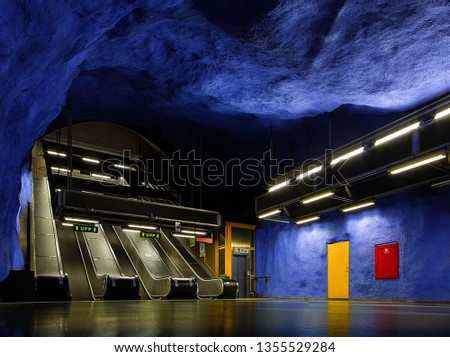 Blue rock underground interior T-Centralen metro station in Stockholm, Sweden. #1355529284